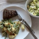 Steak, warm potato salad, salad