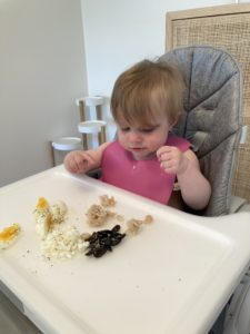feeding baby - Hardboiled egg, goat cheese, black olives and kidney beans sprinkled with hemp hearts
