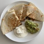 Chicken and bean quesadilla with guacamole and sour cream