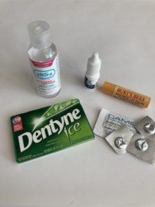 Gum, migraine medication, hand sanitizer, contact rewetting drops & lip balm