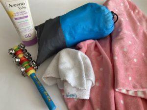 Toy, sunscreen, wash cloth, blanket & waterproof picnic blanket