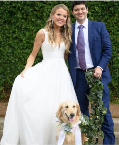 Molly and Justin on their wedding day with their dog, Brooklyn